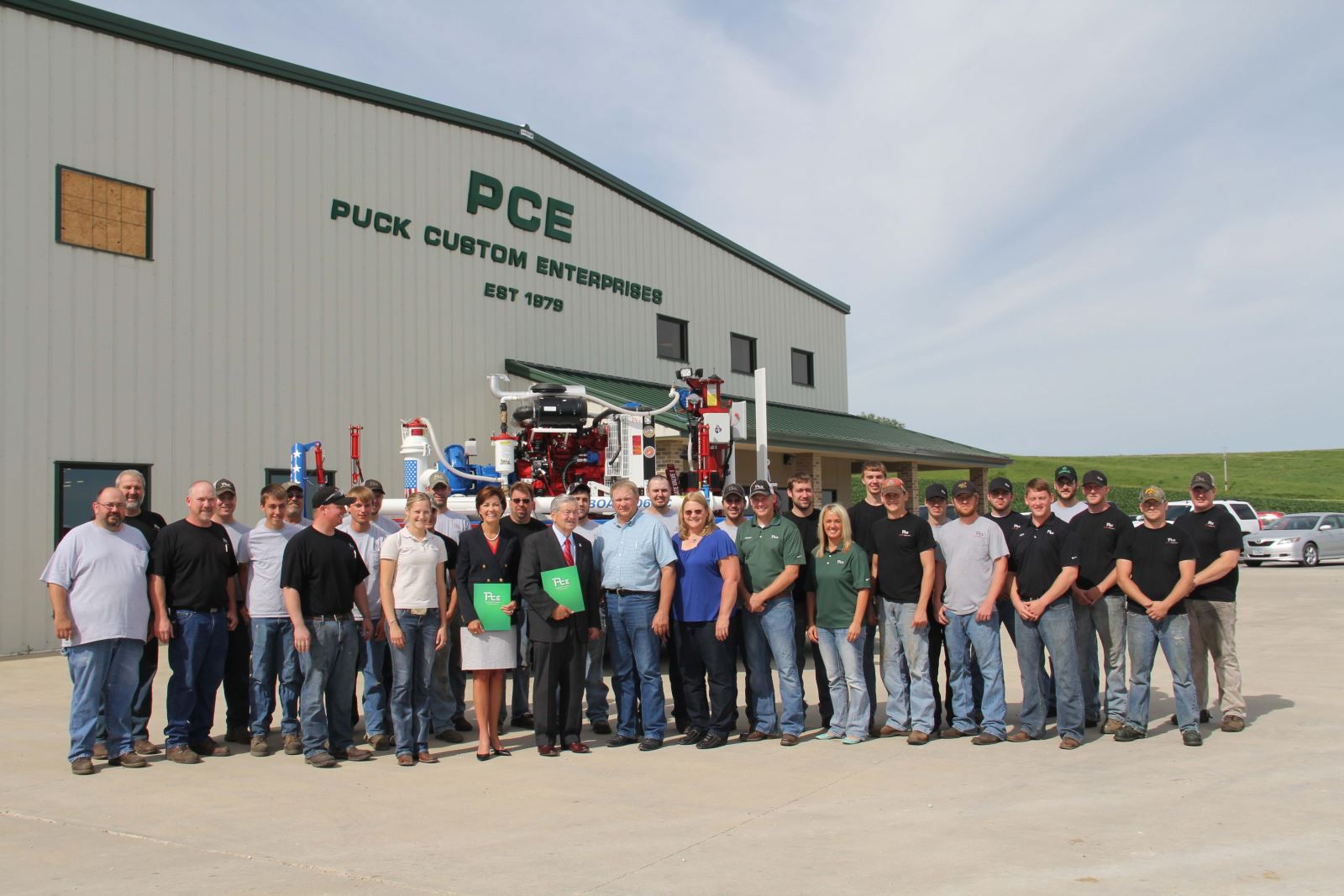 Puck Custom Enterprises Welcomes Visit From Governor Branstad